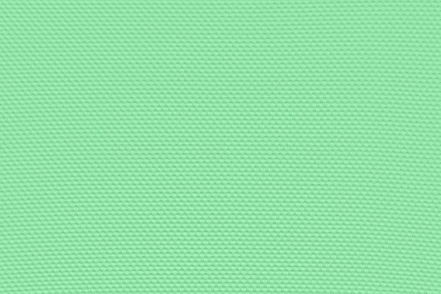 Светлый изумрудно-зеленый фон из текстильного материала.