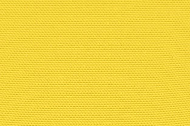 繊維材料から黄金の黄色の背景