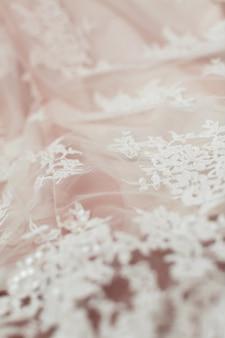 Из белой кружевной ткани. текстура