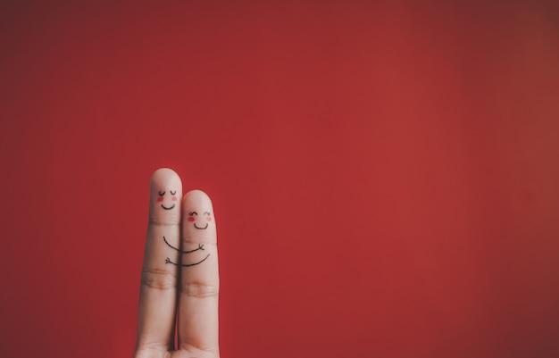 赤い背景の上の感情と指