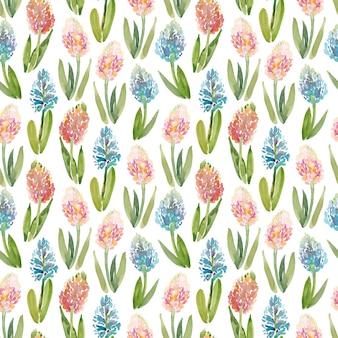 白い背景のヒヤシンスの花と水彩のシームレスパターン