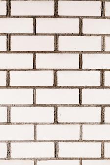 Белая бесшовная кирпичная стена с повторяющимся узором в стиле гранж