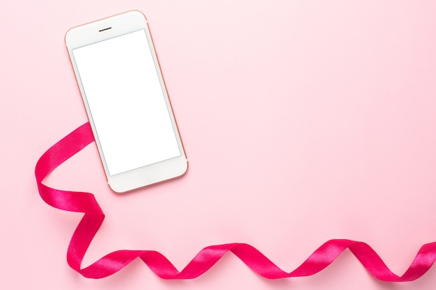 ピンクの携帯電話とギフトリボン