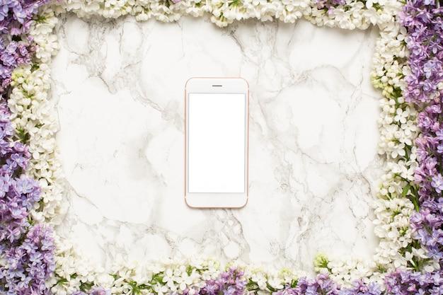 Рамка из белых сиреневых и фиолетовых цветов с телефоном