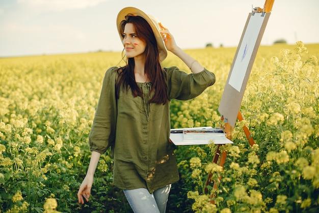 フィールドで絵画エレガントで美しい少女