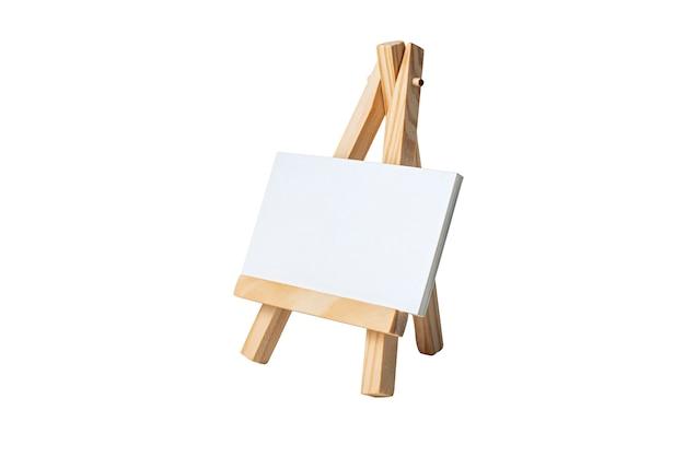 分離された木製イーゼルに空の空白のキャンバスのモックアップします。