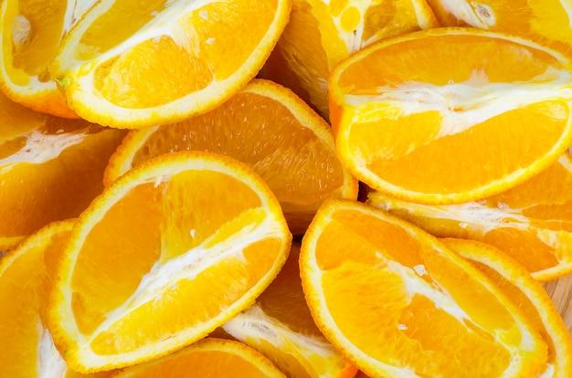 フルーツの背景、オレンジスライスのテクスチャ。