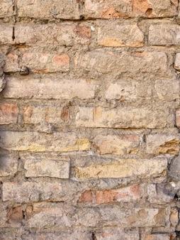 古いレンガの壁の断片。背景、レンガの質感