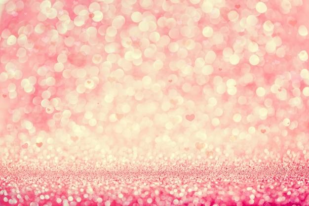 ピンクのキラキラパーティーのボケ味の背景。