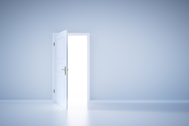 開いたドアから光が輝いています。エントランス