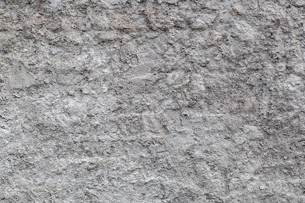 灰色の石の壁の背景のクローズアップ