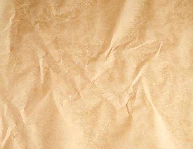しわくちゃ茶色の羊皮紙ベーキングペーパーバックグラウンド