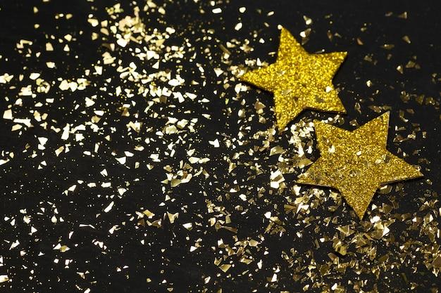 ゴールデンスターとキラキラと新年の黒背景