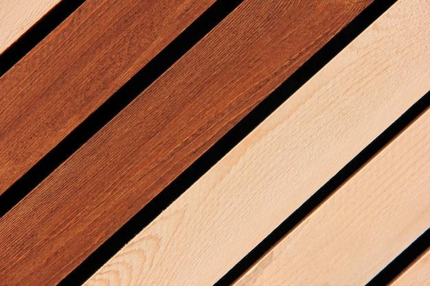 暗いと明るい木の板。木製の背景。