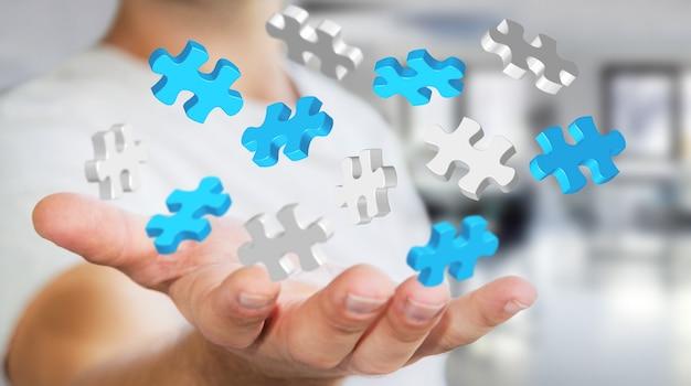 Бизнесмен держит летающие кусочки головоломки