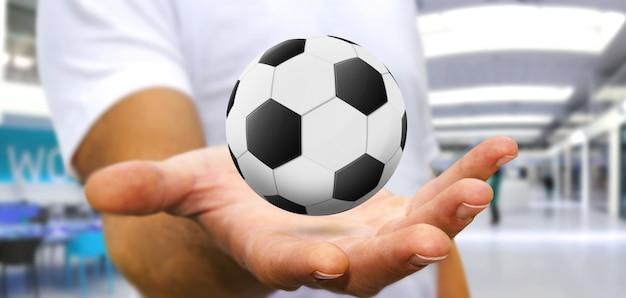 彼の手でサッカーを保持している実業家