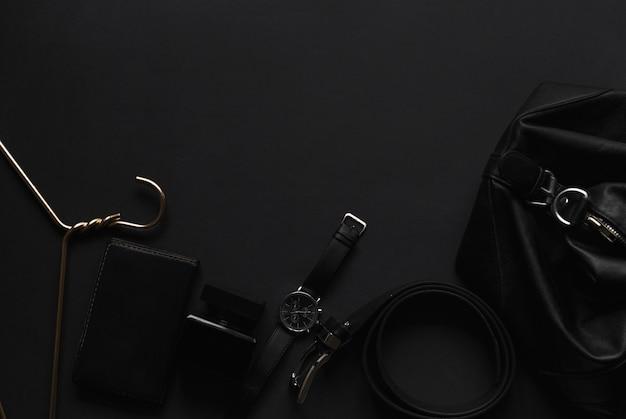 Мужские аксессуары на черном фоне