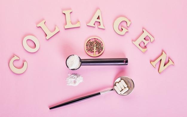 Коллагеновый порошок и таблетки на розовой поверхности. дополнительное потребление белка. натуральная косметическая добавка для кожи, костей, суставов и кишечника. растение или рыба на основе.