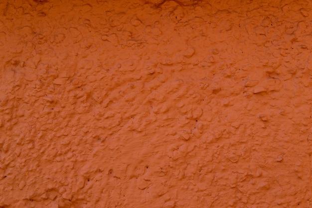 コンクリートの壁の質感はサンゴ色です。生石膏壁の背景
