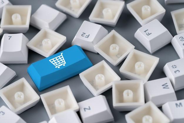 レトロなコンピューターのキーボード上のオンラインショッピングとビジネスのアイコン
