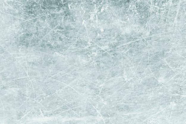 背景としての青い氷、雪の質感を持つ氷