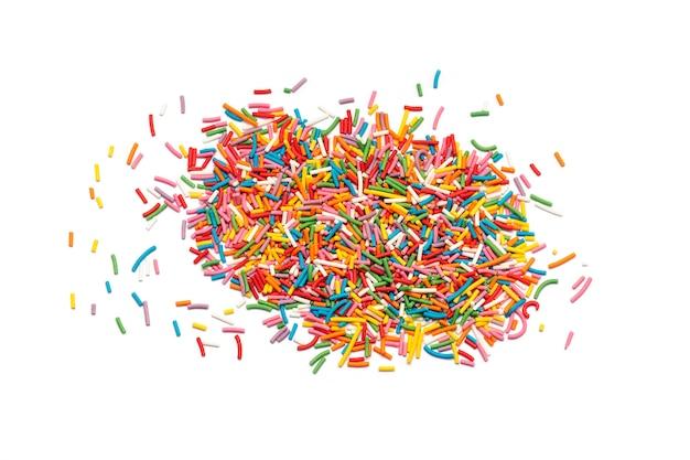 砂糖の振りかけるまたは白で隔離されるキャンディ振りかける