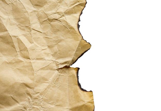 茶色のビンテージの燃やされた紙、分離の詳細、大きな背景、テクスチャ