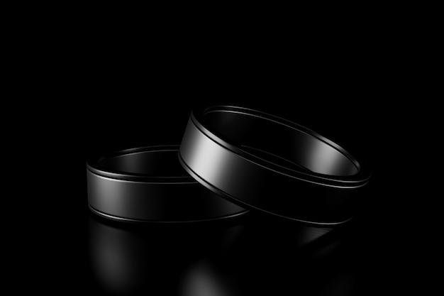 暗闇の中でカップルリングの光と影