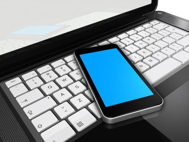 ラップトップ上の携帯電話