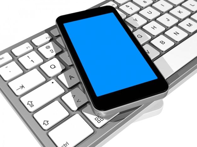 コンピューターのキーボード上の携帯電話
