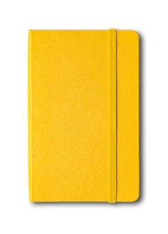 Желтая закрытая тетрадь изолирована