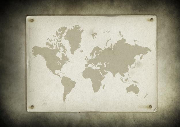 壁に釘付けされたヴィンテージの世界地図羊皮紙
