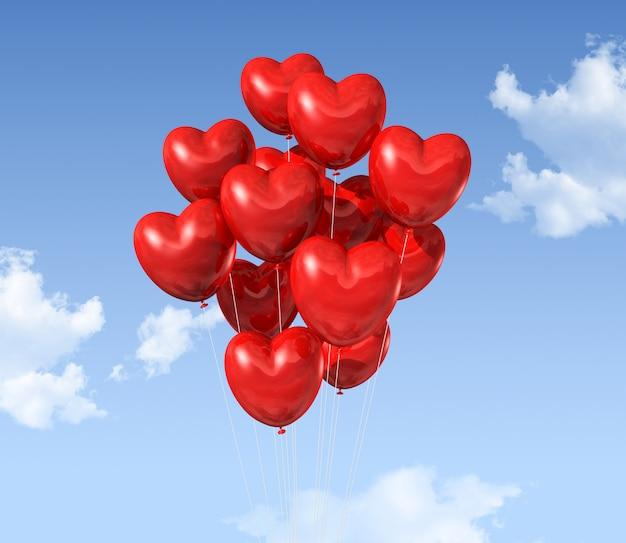 Красные воздушные шары в форме сердца, плавающие в небе