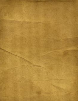 古い茶色の紙テクスチャ背景。グランジ壁紙