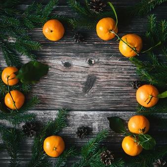 みかんとモミの枝と松ぼっくりのクリスマスホリデーカード