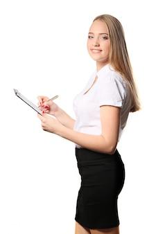 クリップボード、白い背景で隔離の幸せな笑みを浮かべて陽気な若い実業家