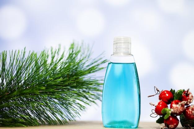 青色の背景にクリスマスの装飾とスパアクセサリー