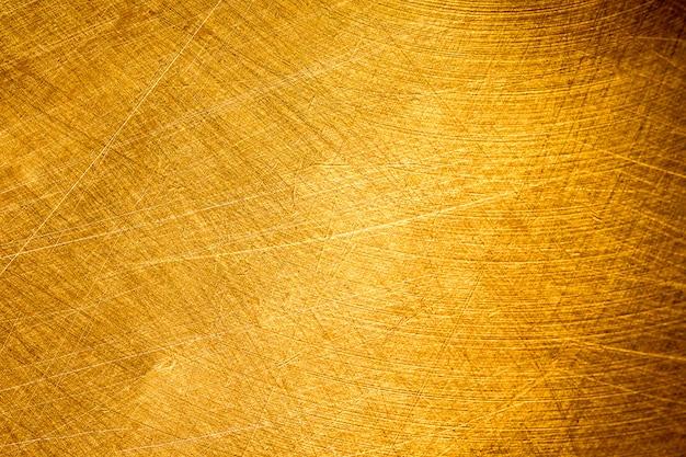 背景の古い金の金属のテクスチャ、パターンは壁紙に使用できます。