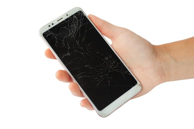 男性の手で白い壊れた携帯電話