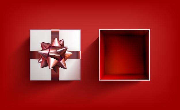 サプライズギフトボックス。現在のベクターリボン。赤の弓と誕生日のお祝いイラスト。