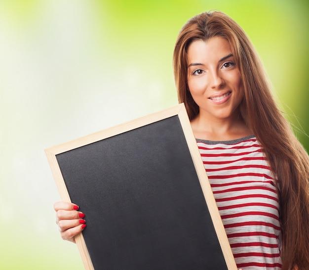 女の子持株黒板のクローズアップ