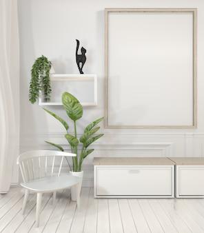 ポスターフレームとホワイトルームのミニマルなデザインのキャビネットと装飾植物。