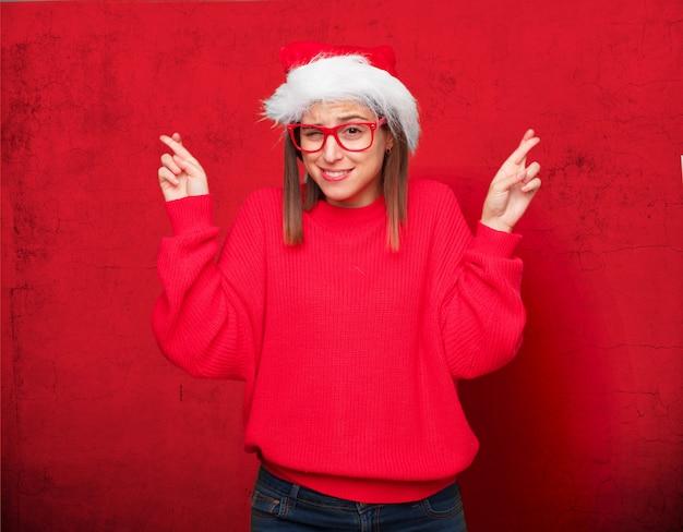 若いきれいな女性クリスマスのコンセプトです。編集可能な背景