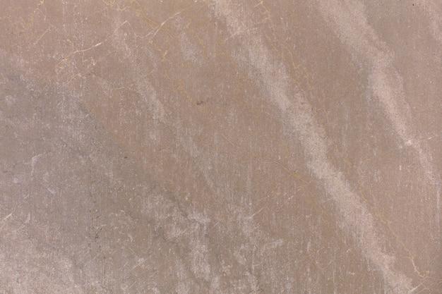 暖かい石灰岩の質感や石の背景。