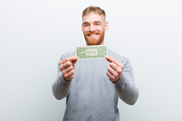 ドルと若い赤い頭の男