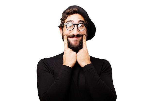 Человек отмечая его улыбку пальцами