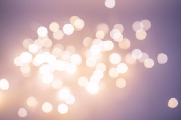 Красивое размытое боке, много ярких художественно размытых кругов. рождественский фон