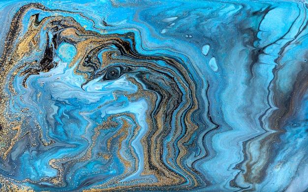青と黒の霜降り背景。黄金の大理石の液体テクスチャ。