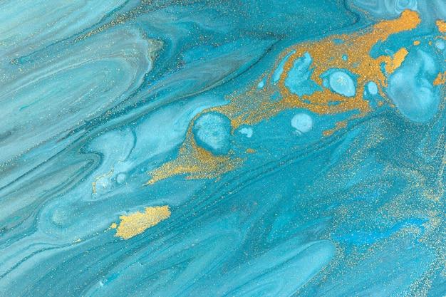 青い霜降り背景。黄金の大理石の液体テクスチャ。