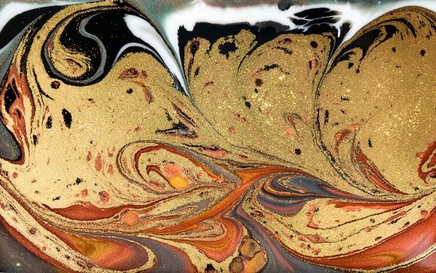 茶色と金色の霜降りの背景。黄金の大理石の液体テクスチャ。